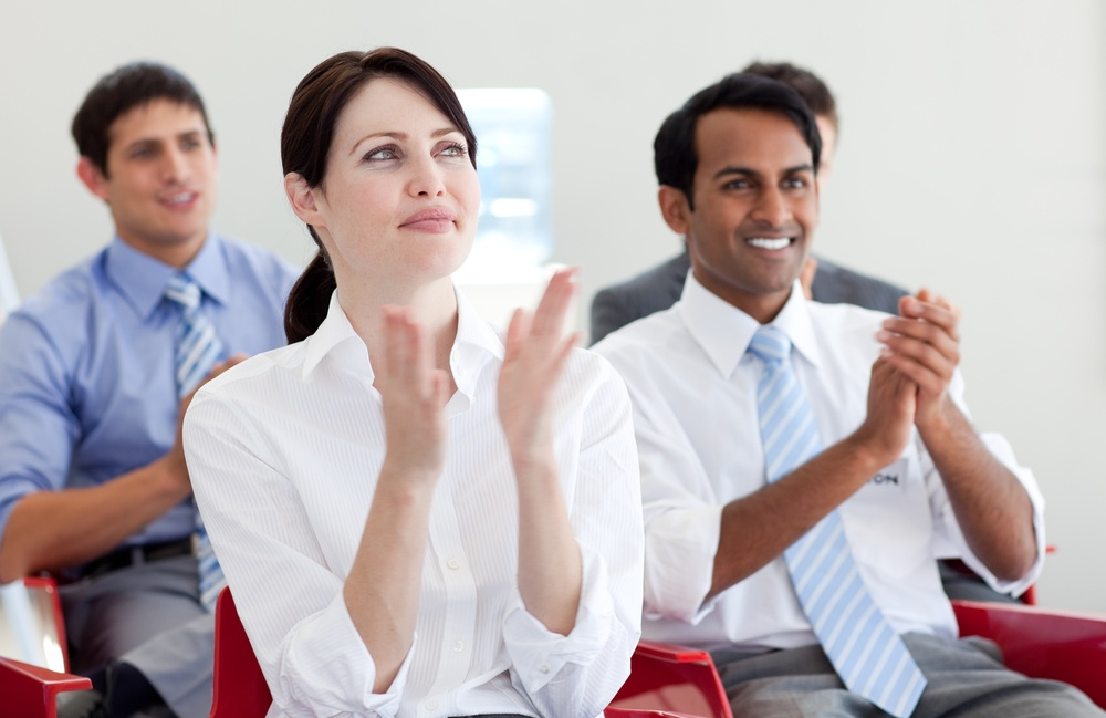Talent Acqusition - International business people clapping at a conference. Business concept..jpeg